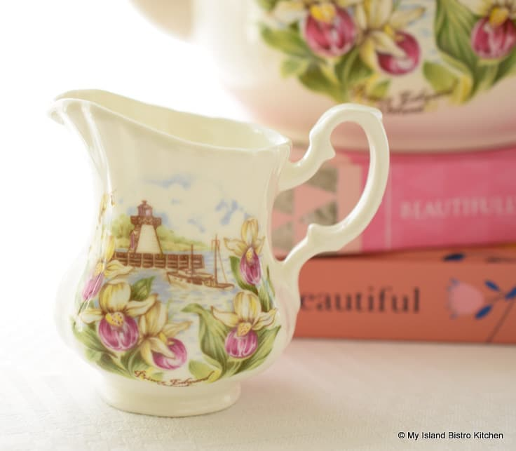 Creamer with flowers, lighthouse, and fishing boat
