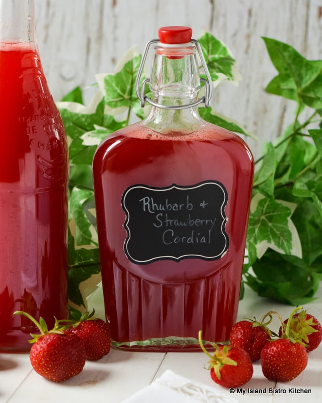 Bottles of Rhubarb and Strawberry Cordial