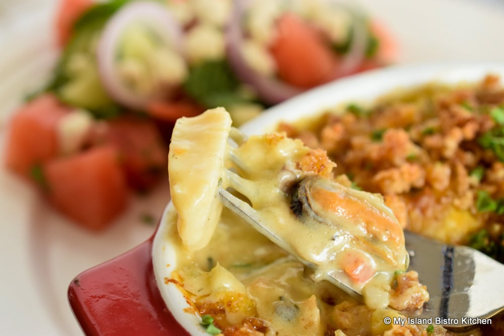 Seafood Casserole Brimming with Scallops, Mussels, Lobster, and Haddock