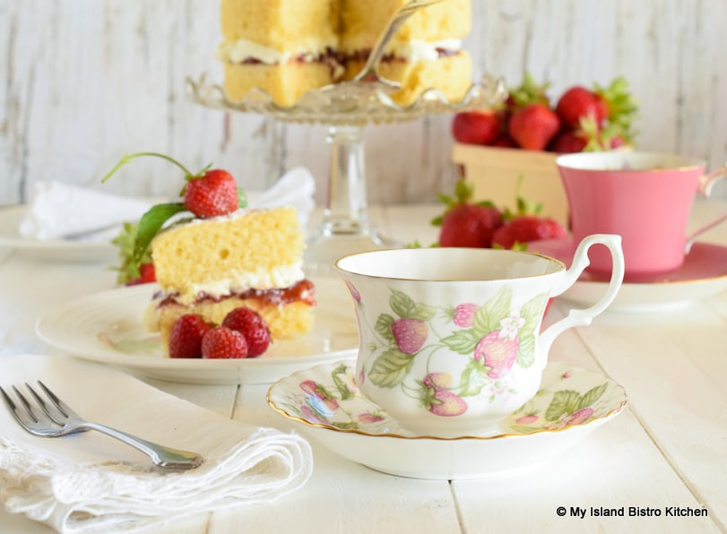 Teatime with a slice of a classic sponge cake