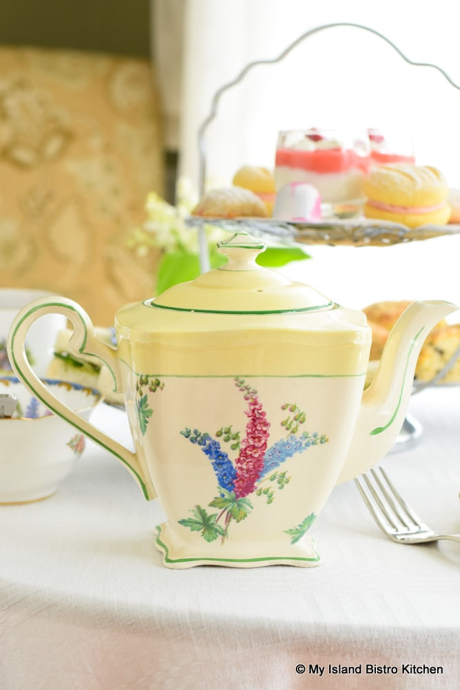 White and yellow teapot with larkspur motif